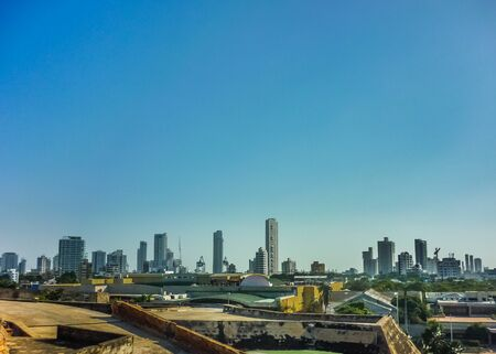 Aerial view from san felipe de barajas fortress of modern buildings at sunny day in Cartagena, the most famous watering place of Colombia. Publikacyjne