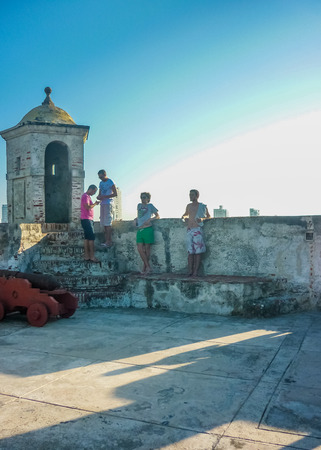 barajas: CARTAGENA, COLOMBIA, JANUARY - 2015 - Group of tourists resting at San Felipe de Barajas Fortress, an spanish colonial style defense building located in Cartagena,  Colombia Editorial