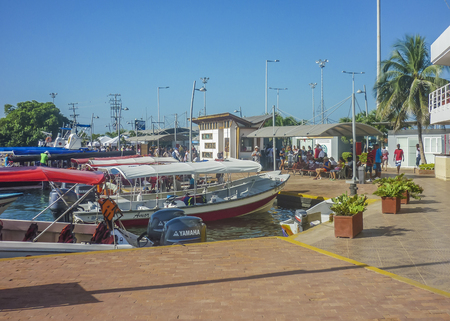 joyride: CARTAGENA, COLOMBIA, JANUARY - 2015 - Tourists waiting to abroad on a boat trip to islands in Cartagena, the most famous seaside resort of Colombia.