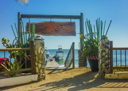 the place is outdoor: CARTAGENA, COLOMBIA, JANUARY - 2015 - Outdoor exit door at tropical island resort in Cartagena, the most famous watering place of Colombia Editorial