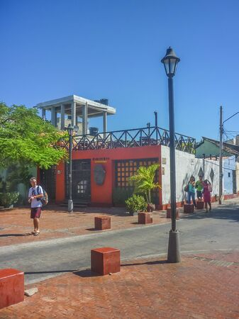 marta: SANTA MARTA, COLOMBIA, JANUARY - 2015 - Beautiful sunny day at traditional street in Santa Marta, one of the most important watering places of Colombia