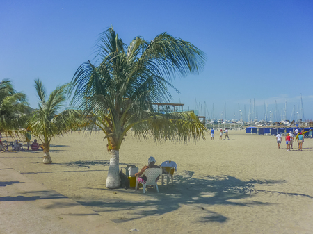 marta: SANTA MARTA, COLOMBIA, JANUARY - 2015 - Beautiful sunny day at tropical beach in Santa Marta, one of the most important watering places of Colombia