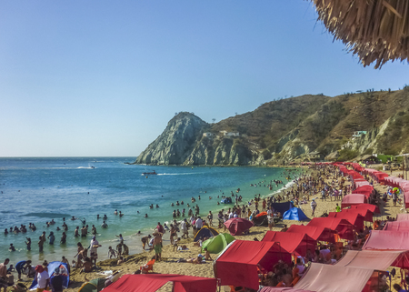 SANTA MARTA, COLOMBIA, JANUARY - 2015 - Sunny day at crowded island beach at El Rodadero, one of the most famous and visited watering places of Colombia.