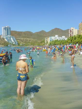 marta: SANTA MARTA, COLOMBIA, JANUARY - 2015 - Sunny day at crowded beach at El Rodadero, one of the most famous and visited watering places of Colombia.
