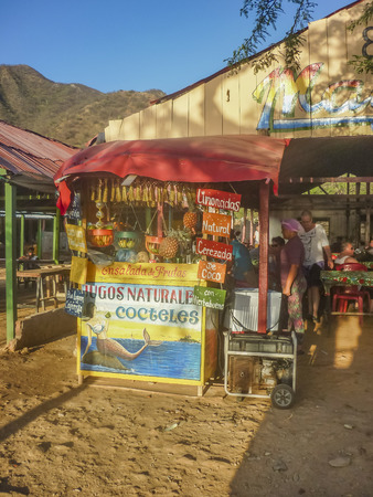 colombian food: TAGANGA, COLOMBIA, JANUARY - 2015 - Traditional and picturesque bar  at the beach at caribbean bay called Taganga, one of the most important watering places in Colombia