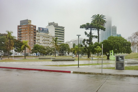 wheater: Urban scene at a misty wheater day in winter in a square of Montevideo, the capital city of Uruguay Editorial