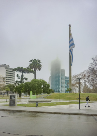 wheater: MONTEVIDEO, URUGUAY, JUNE - 2015 - Urban scene at a misty wheater day in winter in a square of Montevideo, the capital city of Uruguay