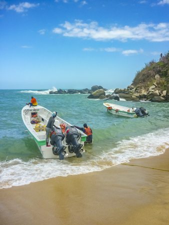 MAGDALENA, COLOMBIA, JANUARY - 2015 - Touristic small boates at Cabo San Juan beach, the most famous beach of tayrona park, a touristic protected area in the colombian northern caribbean region. Editorial