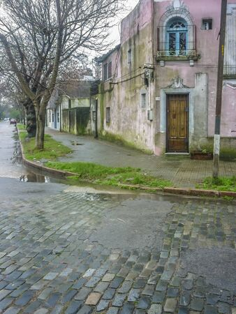 cobbles: Picturesque old house and cobbles street in an ordinary neigbourhood of Montevideo city, the capital of Uruguay