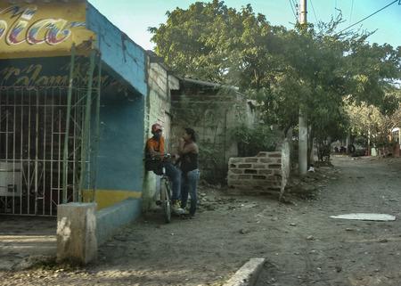 neighbourhood: SANTA MARTA, COLOMBIA, JANUARY - 2015 - Black couple at poor zone neighbourhood  in the outsides of Tayrona Park in Santa Marta, Colombia.