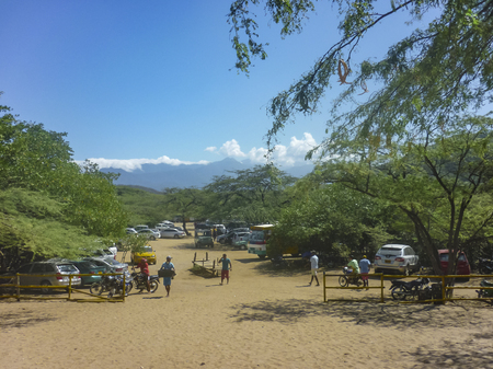 marta: SANTA MARTA, COLOMBIA, JANUARY - 2015 - Parking and entrance of Bahia Concha beach, one of the beaches of Tayrona National Park in Colombia. Editorial