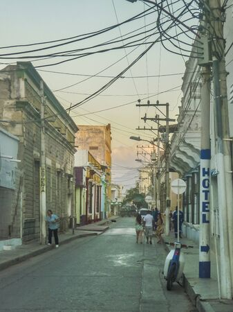 marta: SANTA MARTA, COLOMBIA, JANUARY - 2015 - Almost sunset urban scene in traditional neighbourhood of Santa Marta, one of the most important watering places of Colombia