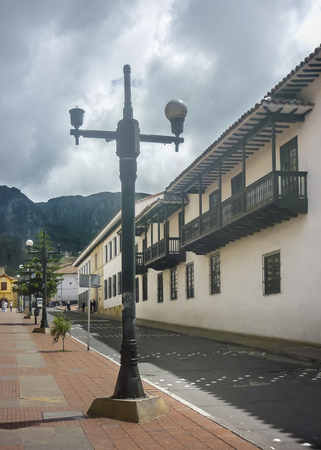 Urban scene with traditional colonial architecture at historic center of Bogota, the capital city of Colombia in South America