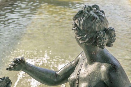 mannerism: Back view classic style sculpture with water at background. Stock Photo