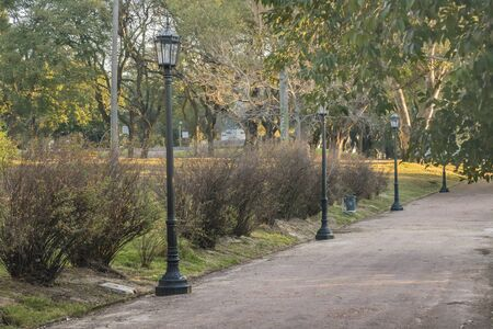 earth road: Parque Rodo park with big trees, retro lamps and earth road in the city of Montevideo, Uruguay Stock Photo