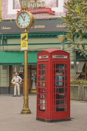 antique booth: BUENOS AIRES, ARGENTINA, AUGUST - 2015 - English phone boot and antique citiy clock in recoleta park in Buenos Aires, Argentina.