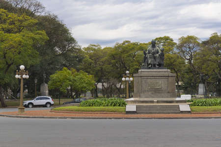 tress: Empty park with a monument sculpture and big tress at background in recoleta, Buenos Aires, Argentina