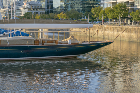 Elegant boat aground in Puerto Madero, a luxury zone at the center of Buenos Aires, Argentina.
