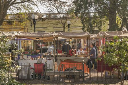 isidro: BUENOS AIRES, ARGENTINA, AUGUST - 2015 - Sunny day with lot of people at Bartolome Mitre square in which is located a famous fair every sunday in San Isidro, Buenos Aires.