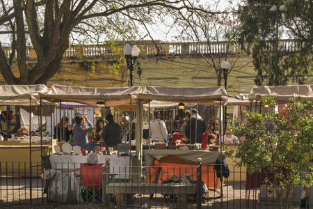 san isidro: BUENOS AIRES, ARGENTINA, AUGUST - 2015 - Sunny day with lot of people at Bartolome Mitre square in which is located a famous fair every sunday in San Isidro, Buenos Aires.