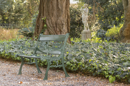Iron chair in the garden of Villa Ocampo, and old style classic building of San Isidro which was the historic home of the famous argentinan intellectual Victoria Ocampo. Stock Photo