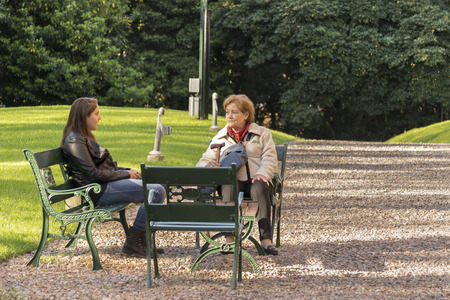 ocampo: BUENOS AIRES, ARGENTINA, AUGUST - 2015 - Grandmother and granddaughter chatting at garden in Villa Ocampo, which was the historic home of the famous argentinian intellectual Victoria Ocampo.