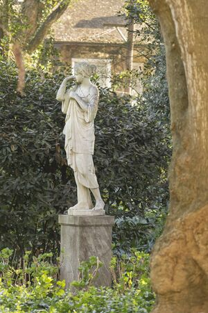 famous women: Beautiful greek or romanic style women sculpture located in the garden of Villa Ocampo, which was the home of the famous argentinian intellectual Victoria Ocampo.