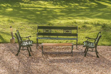 ocampo: Iron chairs and little table at the garden of Villa Ocampo, and old style building of San Isidro which was the home of the famous argentinan intellectual Victoria Ocampo. Stock Photo