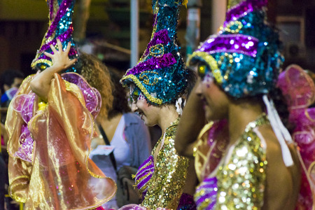 costumed: MONTEVIDEO, URUGUAY, JANUARY - 2016 - Close up view of attractive costumed women at inagural parade of carnival of Montevideo, Uruguay