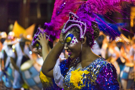 costumed: MONTEVIDEO, URUGUAY, JANUARY - 2016 - Close up view of attractive costumed black woman at inagural parade of carnival of Montevideo, Uruguay