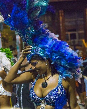 costumed: MONTEVIDEO, URUGUAY, JANUARY - 2016 - Close up view of attractive costumed woman at inagural parade of carnival of Montevideo, Uruguay Editorial