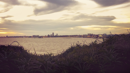 edited photo: Color edited photo of river and skyline of Montevideo from landmark Virgilio square viewpoint.