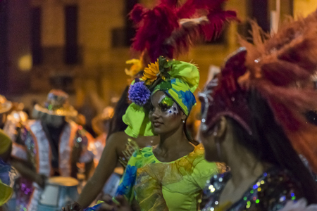 costumed: MONTEVIDEO, URUGUAY, JANUARY - 2016 - Attractive costumed women at inagural parade of carnival of Montevideo, Uruguay