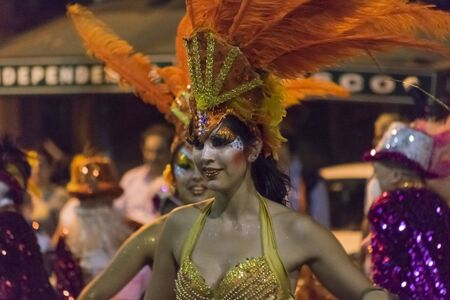 costumed: MONTEVIDEO, URUGUAY, JANUARY - 2016 - Attractive costumed woman dancing at inagural parade of carnival of Montevideo, Uruguay