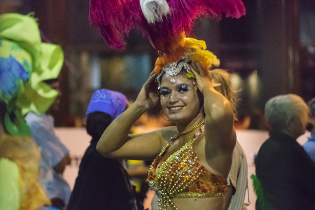 costumed: MONTEVIDEO, URUGUAY, JANUARY - 2016 - Attractive costumed woman watching the camera with a nice smile at the inagural parade of carnival of Montevideo, Uruguay
