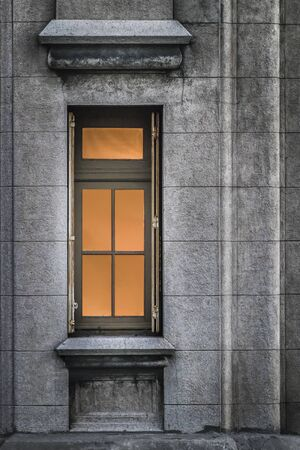 eclectic: Vertical format photo detail of window and concrete wall of the most famous eclectic art deco style building of Uruguay, the Palacio Salvo which is located in his capital Montevideo