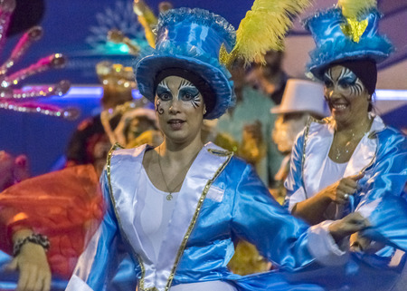 costumed: MONTEVIDEO, URUGUAY, JANUARY - 2016 - Attractive costumed women dancing at inagural parade of carnival of Montevideo, Uruguay