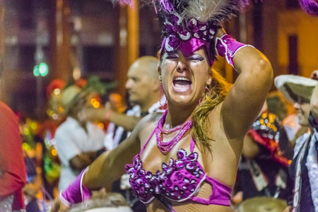 costumed: MONTEVIDEO, URUGUAY, JANUARY - 2016 - Costumed adult woman dancing at inagural parade of carnival of Montevideo, Uruguay Editorial