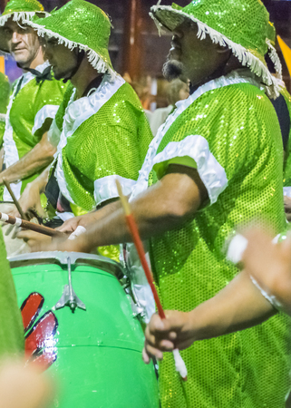 costumed: MONTEVIDEO, URUGUAY, JANUARY - 2016 - Costumed men drummers playing traditional music called candombe at the inaugural parade of carnival of Montevideo, Uruguay Editorial