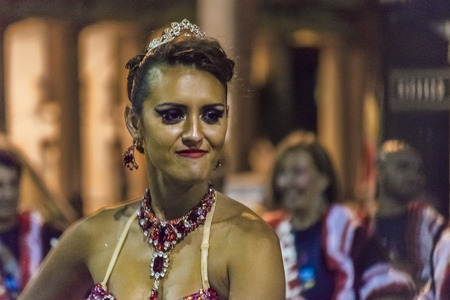 costumed: MONTEVIDEO, URUGUAY, JANUARY - 2016 - Close-up shoot of attractive costumed young woman dancer at inagural parade of carnival of Montevideo, Uruguay