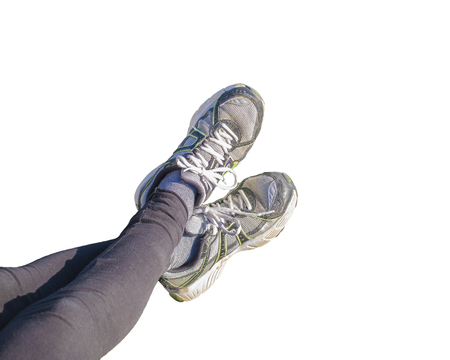 prespective: High angle prespective view of woman legs with black leggings and sports sneakers isolated in white background.