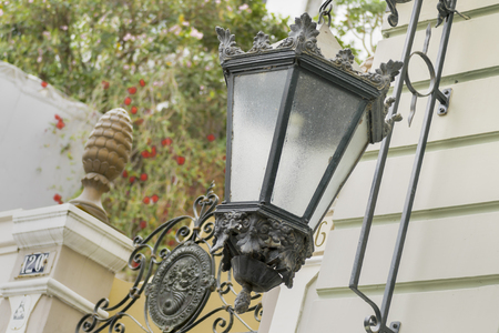 low angle views: Low angle view of antique decorated iron city lamps at historic center Las Penas in Guayaqui, Ecuador