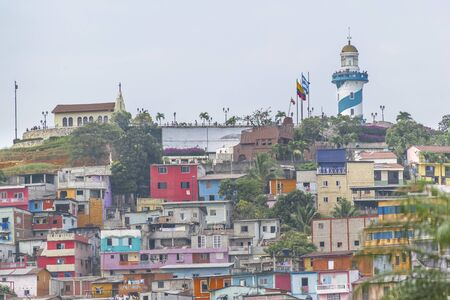 cerro: Low angle view of picturesque colored poor houses at the top of a hill at Cerro Santa Ana in Guayaquil, Ecuador.