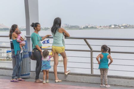 guayaquil: GUAYAQUIL, ECUADOR - OCTOBER - 2015 - Group of women with children watching the river in the boardwalk of Malecon 2000 located in the city of Guayaquil in Ecuador. Editorial