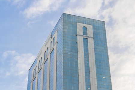 low angle views: Low angle view of postmodern style building with blue sky and clouds at background in Guayaquil, Ecuador Stock Photo
