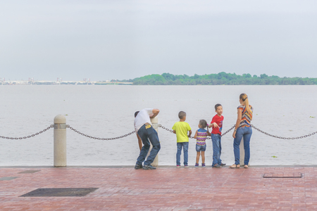 familiy: GUAYAQUIL, ECUADOR - OCTOBER - 2015 -Young familiy at the boardwalk of Malecon 2000 located in the city of Guayaquil in Ecuador.