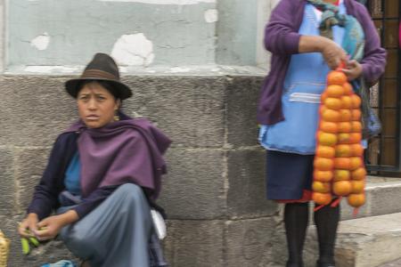 vendor: QUITO, ECUADOR, OCTOBER - 2015 - Traditional women street vendor at historic center of Quito, Ecuador. Editorial