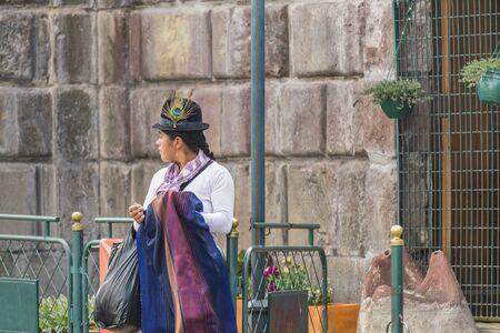 ecuadorian: QUITO, ECUADOR, OCTOBER - 2015  - Traditional costumed ecuadorian young woman at historic center of Quito, the capital city of Ecuador. Editorial