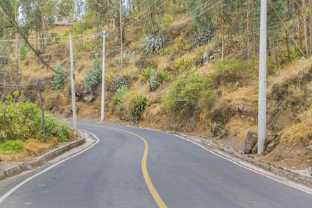 outsides: Empty avenue called troncal de la sierrra in the road towars San Pablo lake in Otavalo outsides village in Ecuador Stock Photo