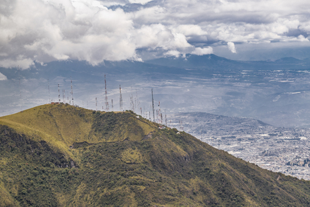 hill range: Andes range mountains landscape scene from the top of Cruz Loma hill  and cityscape of Quito,  Ecuador Stock Photo